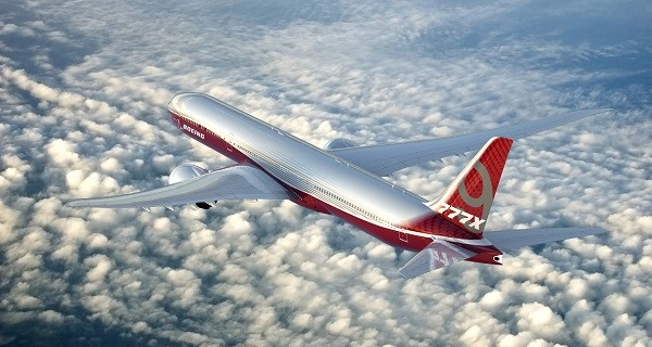 777-9X Images; K66137-03; 777x; view from left ; 777x over clouds; full plane view;